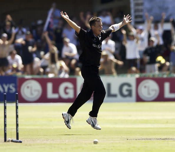 Shane Bond of New Zealand celebrates taking the wicket of Ian Harvey of Australia to finish with figures of 6 for 23