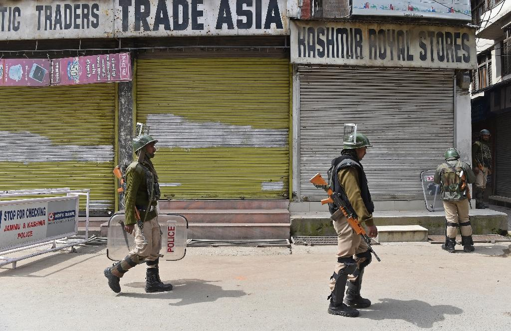 Indian paramilitary troopers patrol in Srinagar during a one-day strike called by Kashmiri separatists against Prime Minister Narendra Modi's visit