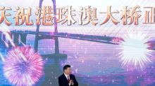 China's Xi opens major sea bridge during symbolic tour to southern China