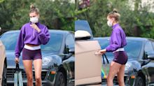 Hailey Bieber flashes toned abs and legs in'80s-inspired workout gear