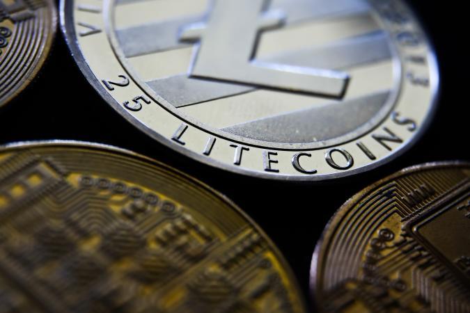 Representation of Bitcoin, Ripple, Litecoin and Ethereum cryptocurrencies is seen in this illustration photo taken in Krakow, Poland on June 6, 2021. (Photo Illustration by Jakub Porzycki/NurPhoto via Getty Images)