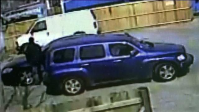 Surveillance video captures men breaking into cars in Marquette Park