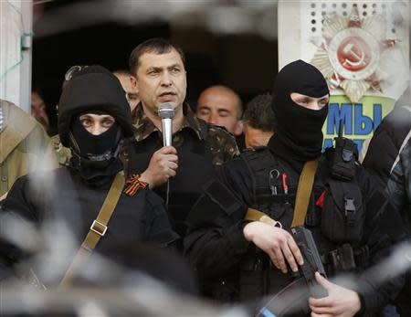 The self-styled mayor of Luhansk region Valery Bolotov speaks during a rally in front of the seized office of the SBU state security service in Luhansk, eastern Ukraine April 25, 2014. REUTERS/Vasily Fedosenko
