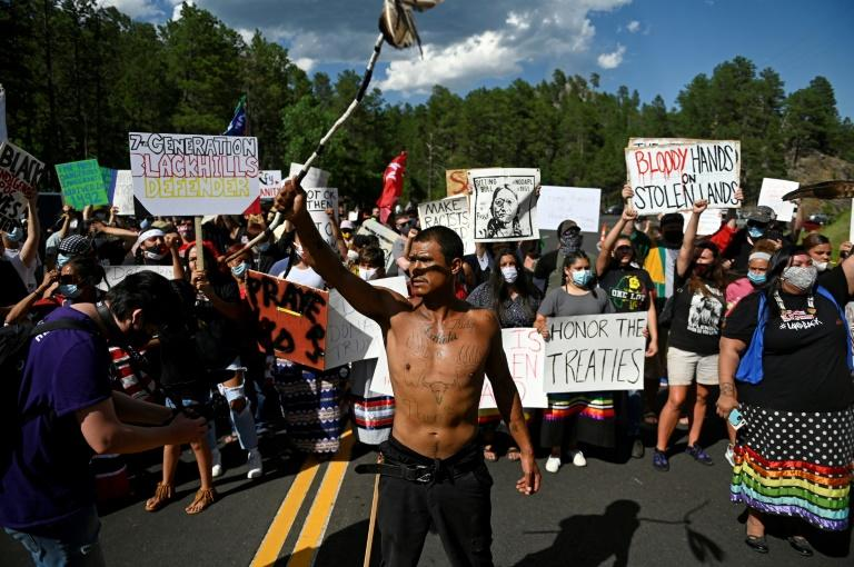Activists and members of different tribes block a road near Mount Rushmore as they protest the US government (AFP Photo/ANDREW CABALLERO-REYNOLDS)