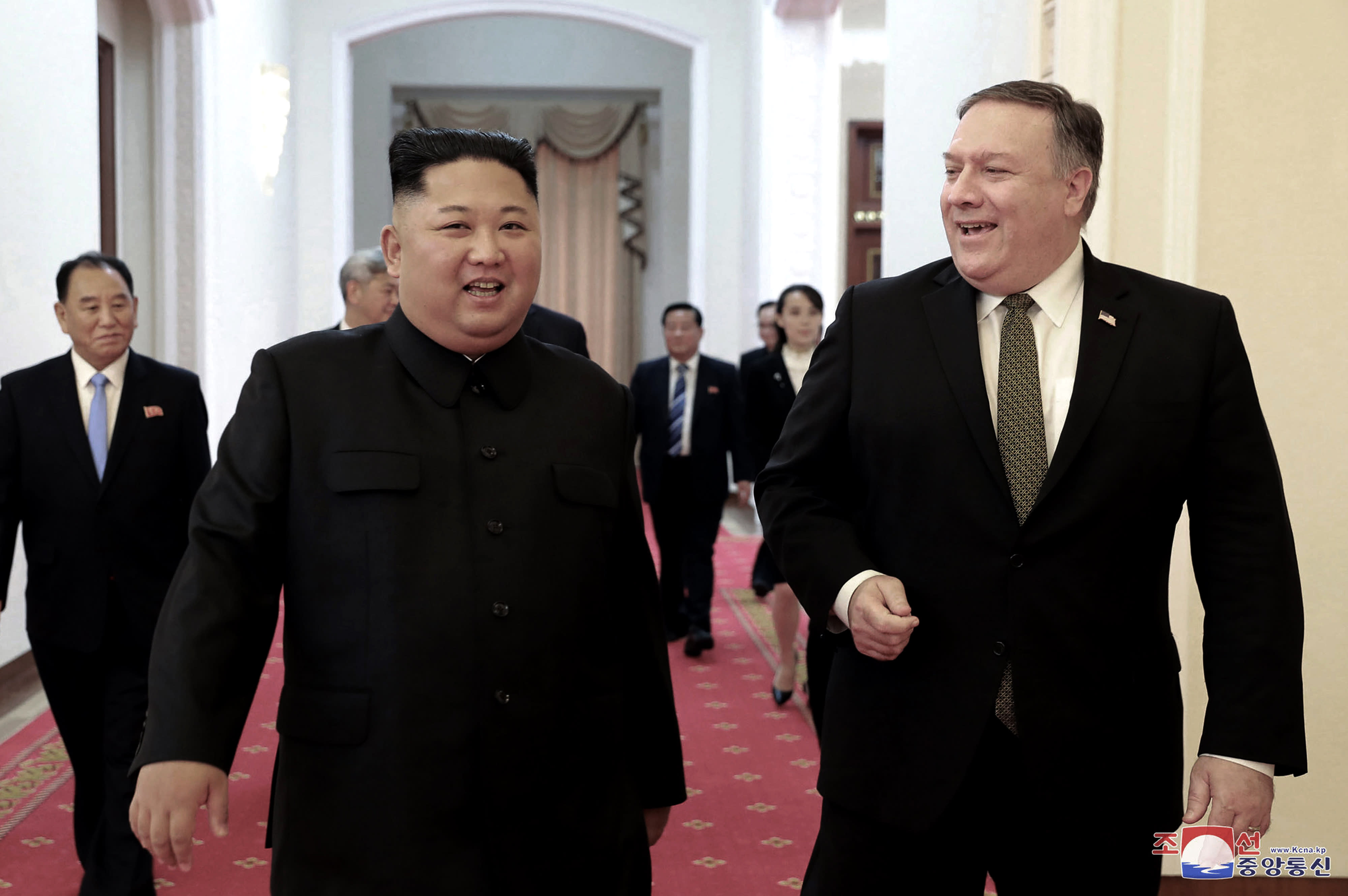 "FILE - In this Oct. 7, 2018, file photo provided by the North Korean government, North Korean leader Kim Jong Un, center left, and U.S. Secretary of State Mike Pompeo walk together before their meeting in Pyongyang, North Korea. North Korea said Thursday, April 18, 2019, that it had test-fired a new type of ""tactical guided weapon,"" its first such test in nearly half a year, and demanded that Washington remove Pompeo from nuclear negotiations. Korean language watermark on image as provided by source reads: ""KCNA"" which is the abbreviation for Korean Central News Agency. (Korean Central News Agency/Korea News Service via AP, File)"