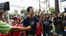 Two Thai protesters arrested for 'violence against queen'