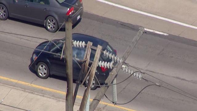 Downed power lines cause traffic jam