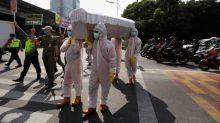 In Indonesia, shock coffin tactics nail coronavirus risks