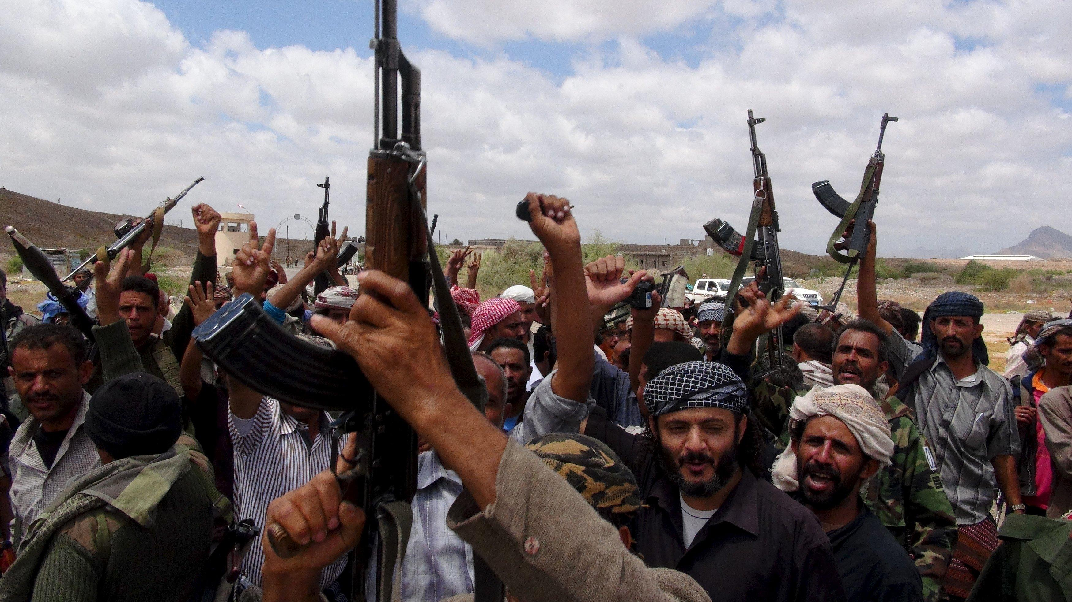 Southern People's Resistance militants loyal to Yemen's President Abd-Rabbu Mansour Hadi celebrate seizing the al-Anad air base in the country's southern province of Lahej March 22, 2015. Houthi fighters opposed to Yemen's president took over the central city of Taiz in an escalation of a power struggle diplomats say risks drawing in neighboring oil giant Saudi Arabia and its main regional rival Iran. Residents of Taiz, on a main road from the capital Sanaa to the country's second city of Aden, said that Houthi militias took over the city's military airport without a struggle from local authorities late on Saturday. REUTERS/Nabeel Quaiti