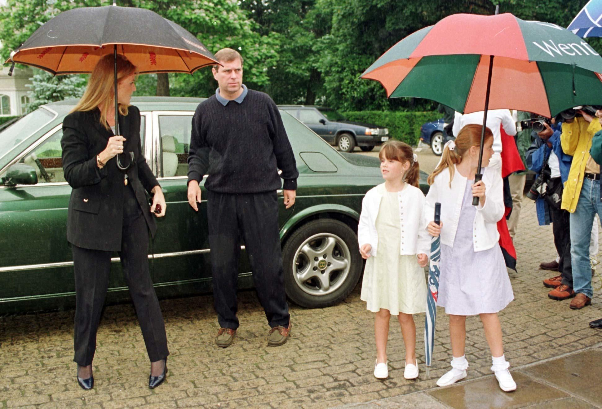 The Duke and Duchess of York arriving at Wentworth Golf Club, Surrey,  with their daughters Princesses Beatrice  (right) and Eugenie, for the Duchess of York's fifth Charity Golf tournament in aid of the Motor Neurone Disease Association. y ROYAL Golf.