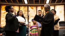 Minnesota county's first black commissioner takes oath with 'The New Jim Crow' book
