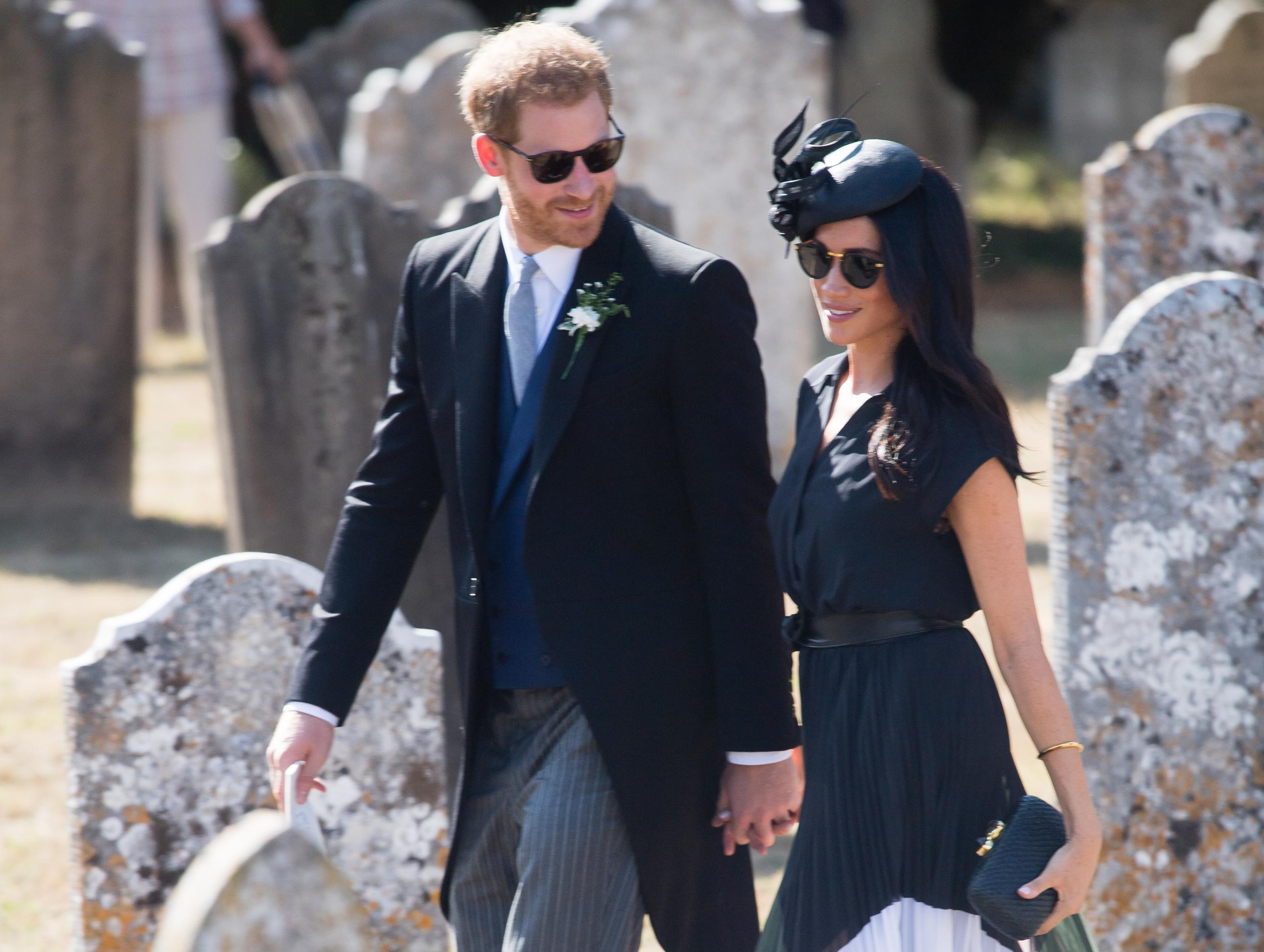 FRENSHAM, UNITED KINGDOM - AUGUST 04:  Prince Harry, Duke of Sussex and Meghan, Duchess of Sussex attends the wedding of Charlie Van Straubenzee on August 4, 2018 in Frensham, United Kingdom. Prince Harry attended the same prep school as Charlie van Straubenzee and have been good friends ever since.  (Photo by Samir Hussein/Samir Hussein/WireImage)