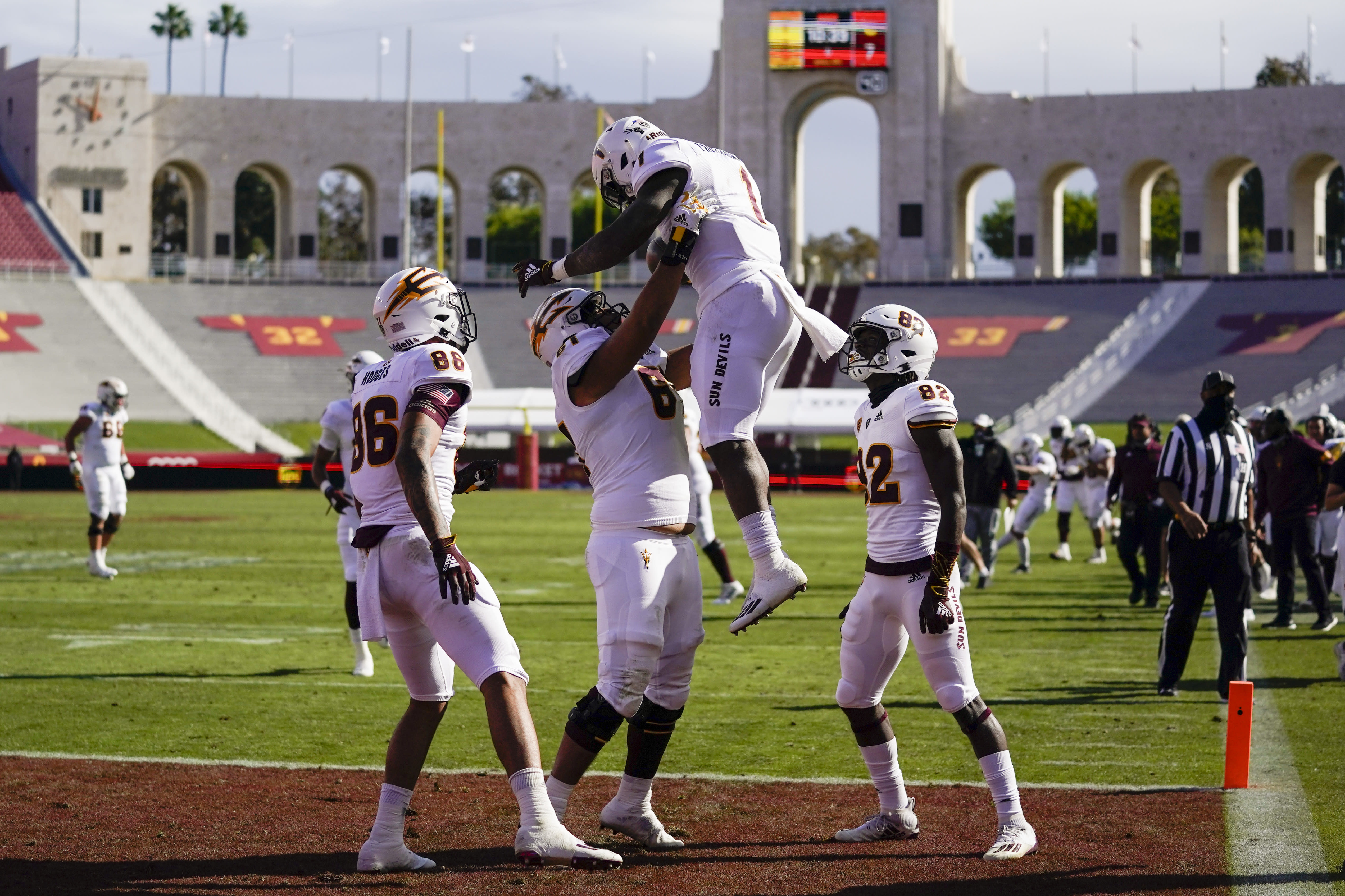 Arizona State running back Chip Trayanum (1) celebrates with teammates after scoring a touchdown against Southern California during the first half of an NCAA college football game is the phrase Saturday, Nov. 7, 2020, in Los Angeles. (AP Photo/Ashley Landis)
