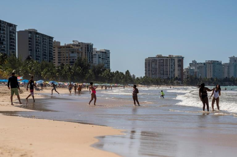 People continued to visit the beach in Puerto Rico despite the governor's effort to keep them at home in an effort to fight the coronavirus pandemic (AFP Photo/Ricardo ARDUENGO)