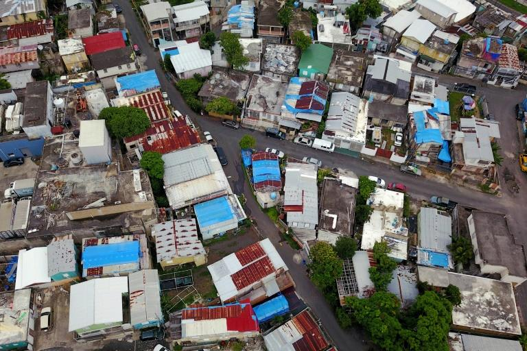 Blue tarps given out by FEMA cover several roofs two years after Hurricane Maria hit Puerto Rico. (AFP Photo/Ricardo ARDUENGO)