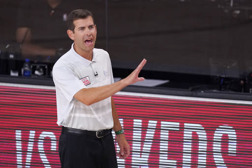 Boston Celtics head coach Brad Stevens yells to his players during the second half of an NBA conference final playoff basketball game against the Miami Heat Friday, Sept. 25, 2020, in Lake Buena Vista, Fla. (AP Photo/Mark J. Terrill)
