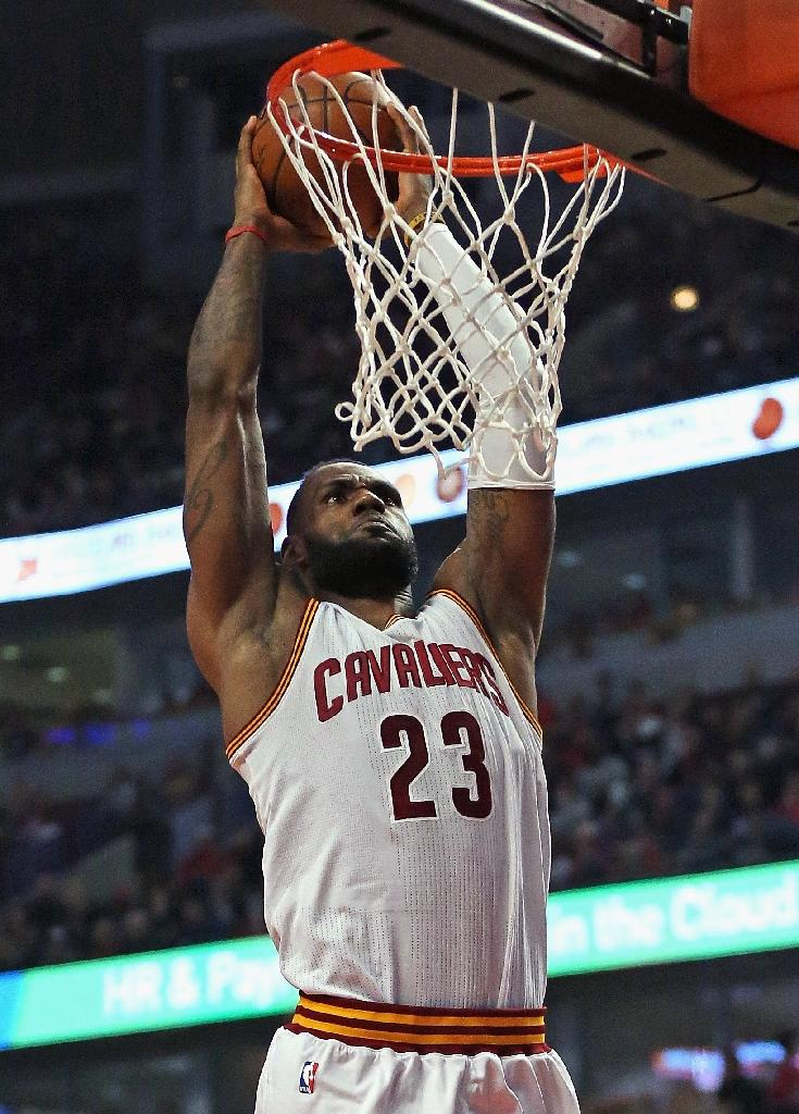 new style 5d236 42cde LeBron James of the Cleveland Cavaliers dunks during a NBA game at the  United Center in
