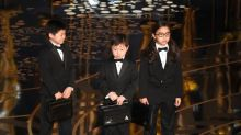 That Adorable Asian Kid Didn't Know She'd Be the Butt of Chris Rock's Oscars Joke — and Neither Did Her Mom