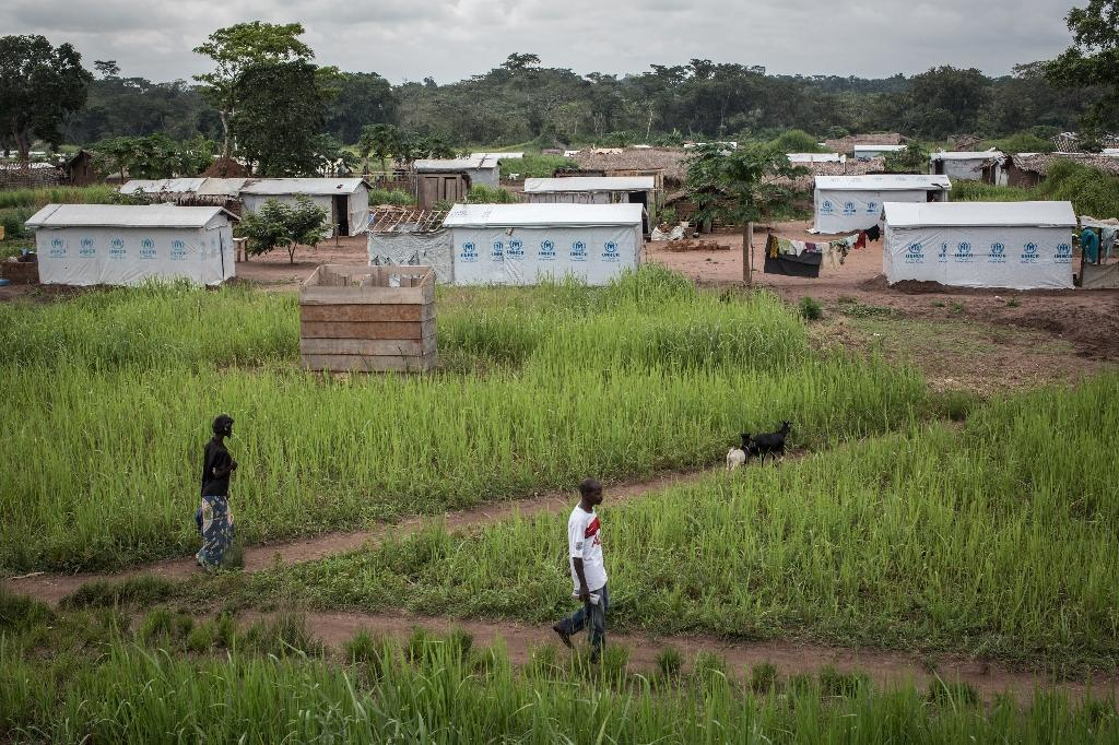 People walk in the Boyabu refugee camp, in the Democratic Republic of Congo, on June 23, 2015, home to aroud 18,500 refugees from the Central African Republic