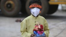 India eases virus restrictions even as cases soar