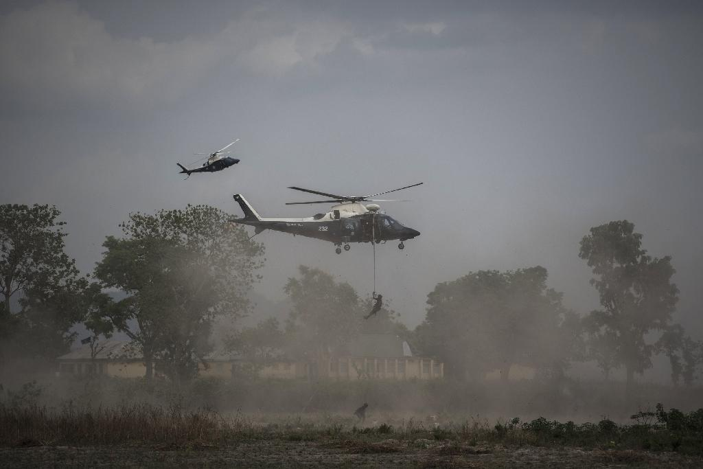 Soldiers rappelled from helicopters as part of a military demonstration near the Nigerian capital Abuja before Africa's senior commanders (AFP Photo/STEFAN HEUNIS)