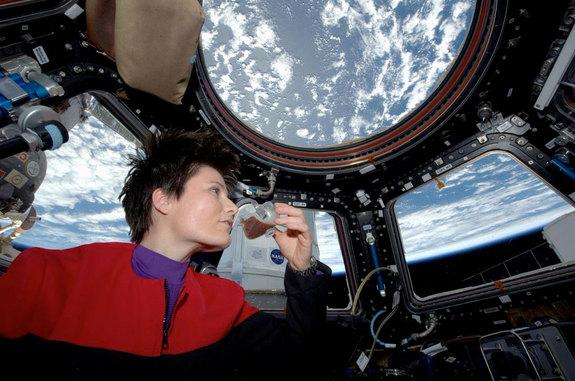 Astronaut Samantha Cristoforetti enjoys the first cup of coffee to be brewed on the International Space Station on Sunday, May 3, 2015.