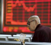 Asian stocks rise, oil soars on Iran sanctions worries