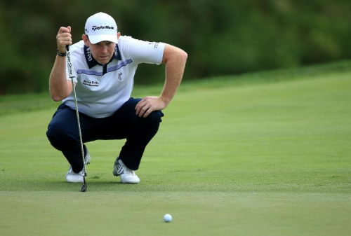 Stephen Gallacher of Scotland lines up a putt on the third hole during the first round of the 96th PGA Championship at Valhalla Golf Club on August 7, 2014 in Louisville, Kentucky
