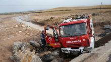Floods kill firefighter in southern Spain