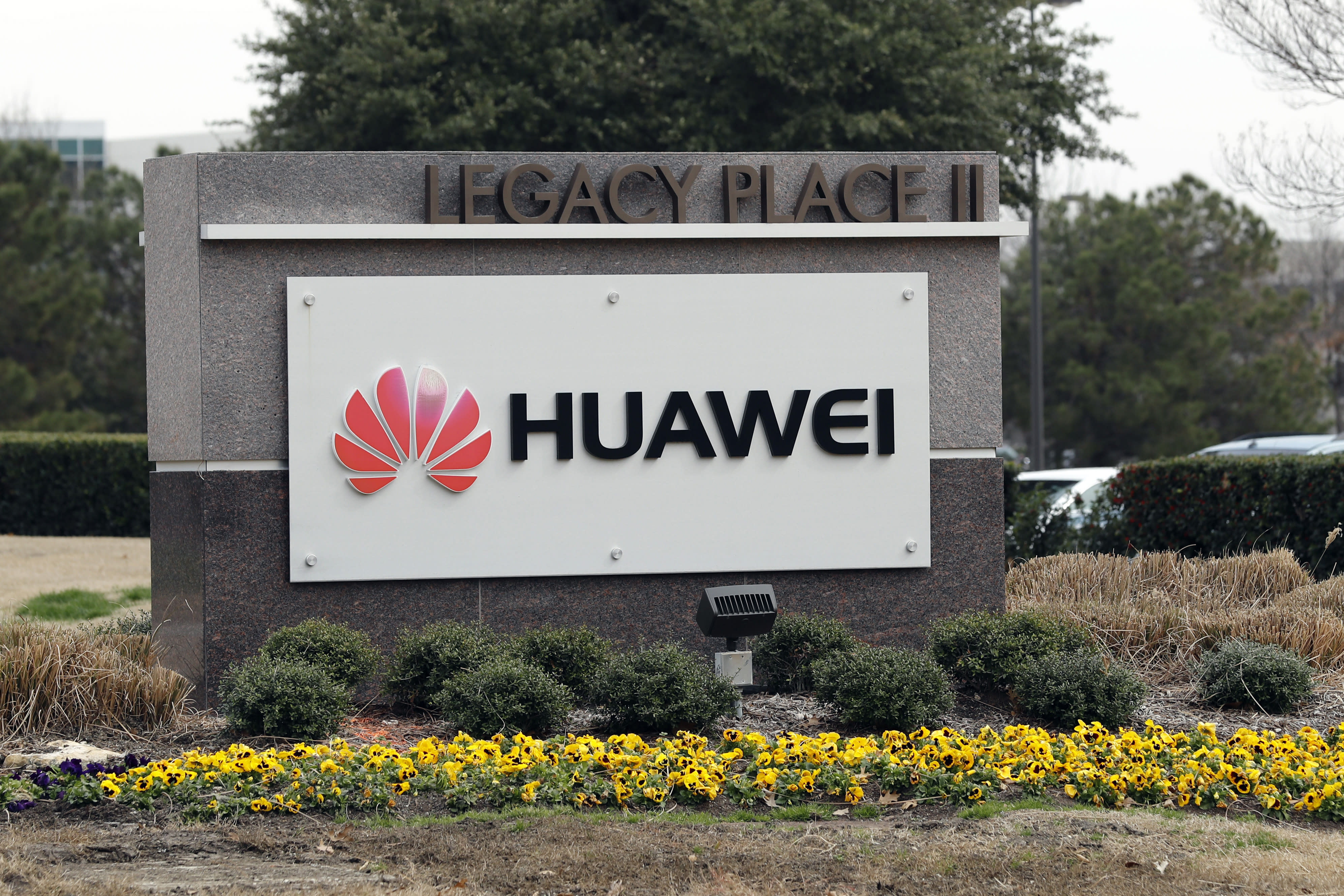 """FILE - In this March 7, 2019, file photo, a sign is displayed outside the Huawei Technologies Ltd. business location in Plano, Texas. China on Wednesday, July 1, 2020 demanded Washington stop """"oppressing Chinese companies"""" after U.S. regulators declared telecom equipment suppliers Huawei and ZTE to be national security threats. (AP Photo/Tony Gutierrez, File)"""