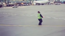'Honestly, I just love what I do': Airport worker who guides planes wows passengers with his eccentric dance moves