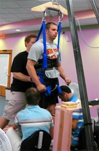 Paralyzed man can stand and walk again, thanks to spinal implant