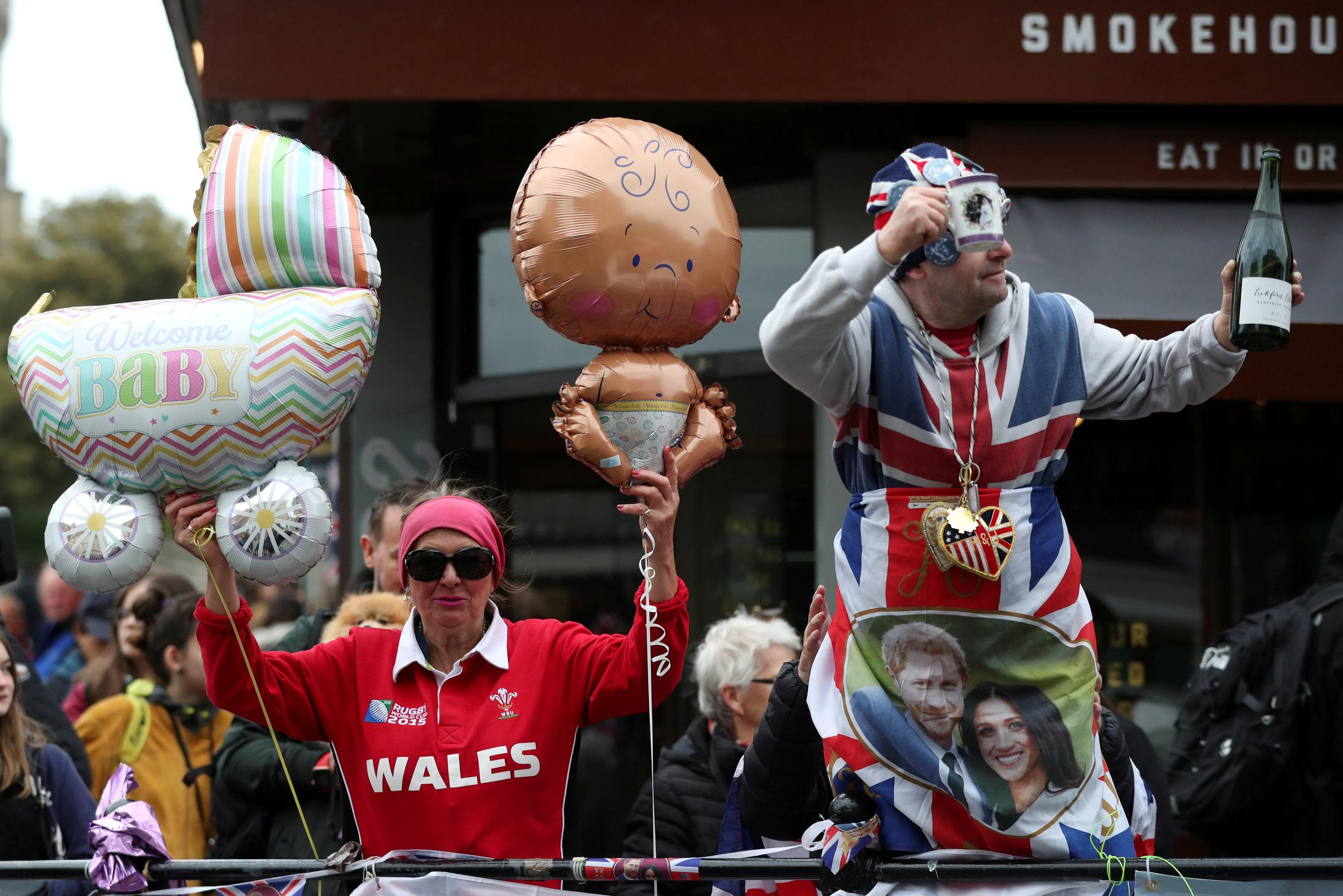 People celebrate outside Windsor Castle after Britain's Meghan, the Duchess of Sussex gave birth to a boy, in Windsor, Britain May 6, 2019. REUTERS/Hannah McKay