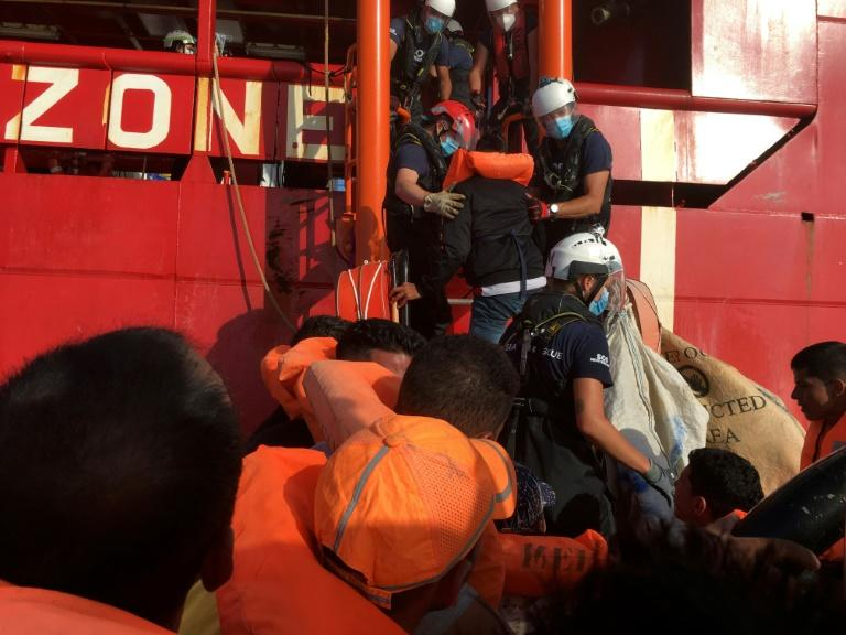 Migrants are rescued by members of French NGO SOS Mediterranee off the coast of Lampedusa on June 25, 2020 (AFP Photo/Shahzad ABDUL)