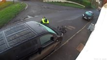 Cyclist slips on ice slamming into a parked van