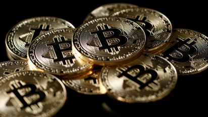 Bitcoin slides on crackdown fears, hits 4-week low