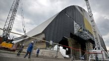 Giant safety arch begins sliding over Chernobyl