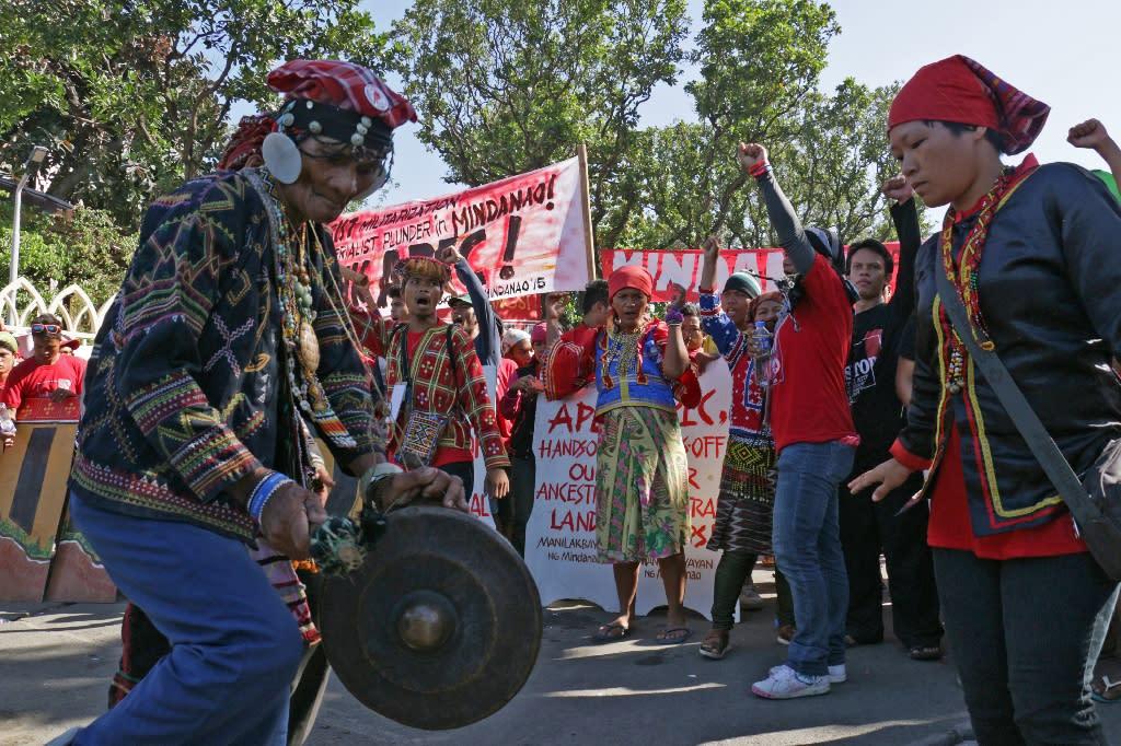 Lumad people protest against the Asia Pacific Economic Cooperation (APEC) Summit on November 19, 2015 (AFP Photo/Joseph Agcaoili)