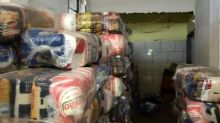 Milícia da Baixada cobra até pela cesta básica que moradores da região compram