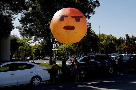 Inflatable angry emoji looms over Facebook annual meeting as users