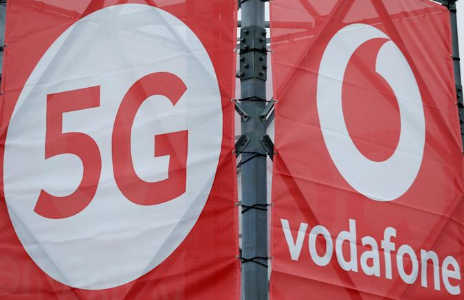 Logos of 5G technology and telecommunications company Vodafone are pictured at the 5G Mobility Lab of Vodafone in Aldenhoven, Germany, November 27, 2018. Picture taken November 27, 2018. REUTERS/Thilo Schmuelgen