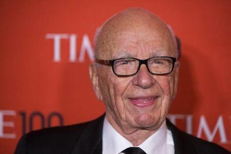 Murdoch arrives at the Time 100 gala celebrating the magazine's naming of the 100 most influential people in the world for the past year, in New York