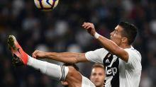Ronaldo celebrates landmark goal but Juve's perfect run broken