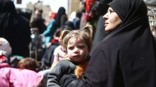 Syria rebels depart eastern Ghouta town on government buses in first surrender