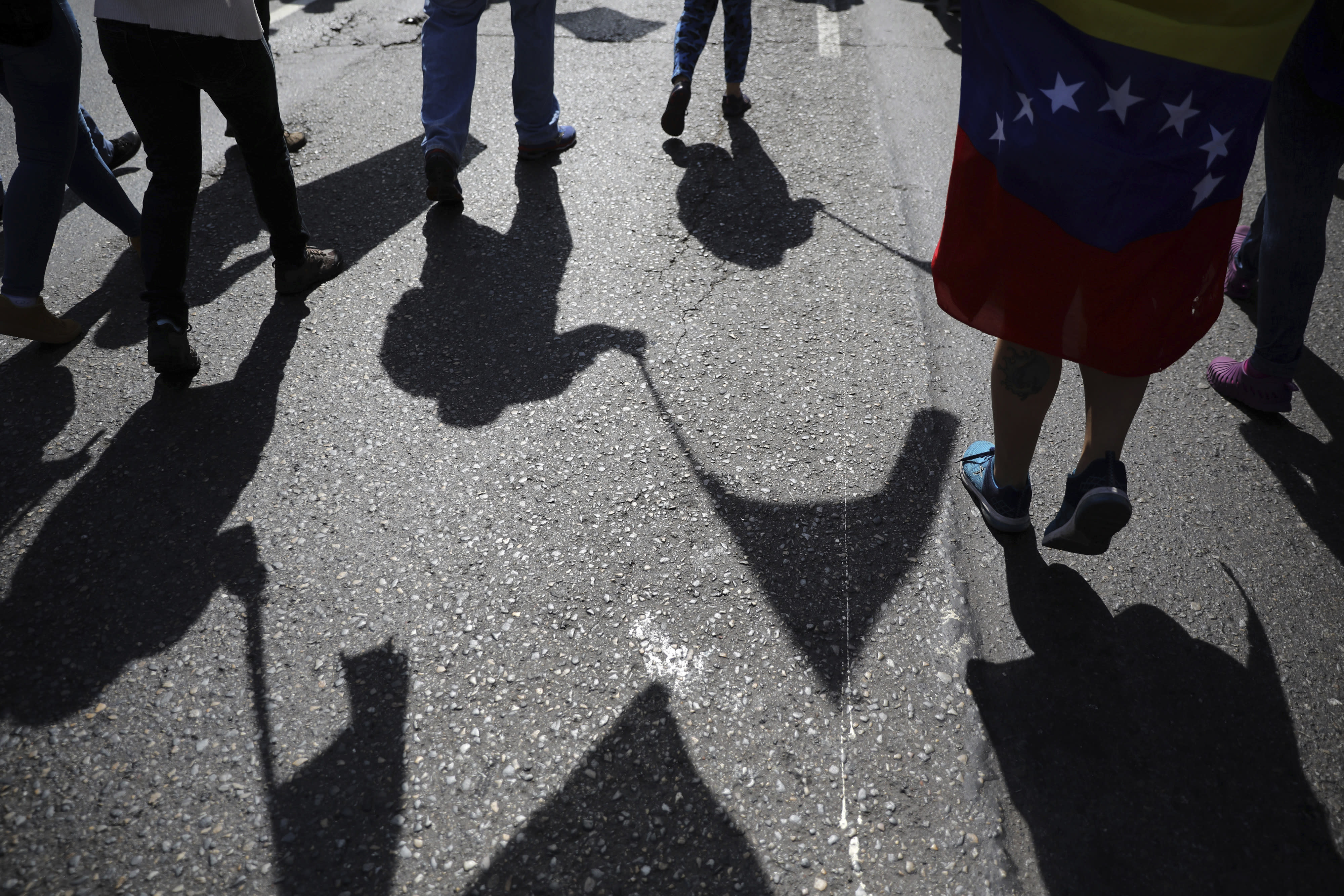Anti-government protesters gather for the start of a nationwide demonstration demanding the resignation of President Nicolas Maduro, in Caracas, Venezuela, Saturday, Feb. 2, 2019. Momentum is growing for Venezuela's opposition movement led by lawmaker Juan Guaido, who has called supporters back into the streets for nationwide protests Saturday, escalating pressure on embattled Maduro to step down. (AP Photo/Rodrigo Abd)