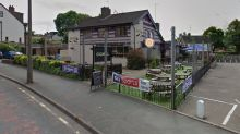 Four injured after car driven into crowd outside pub