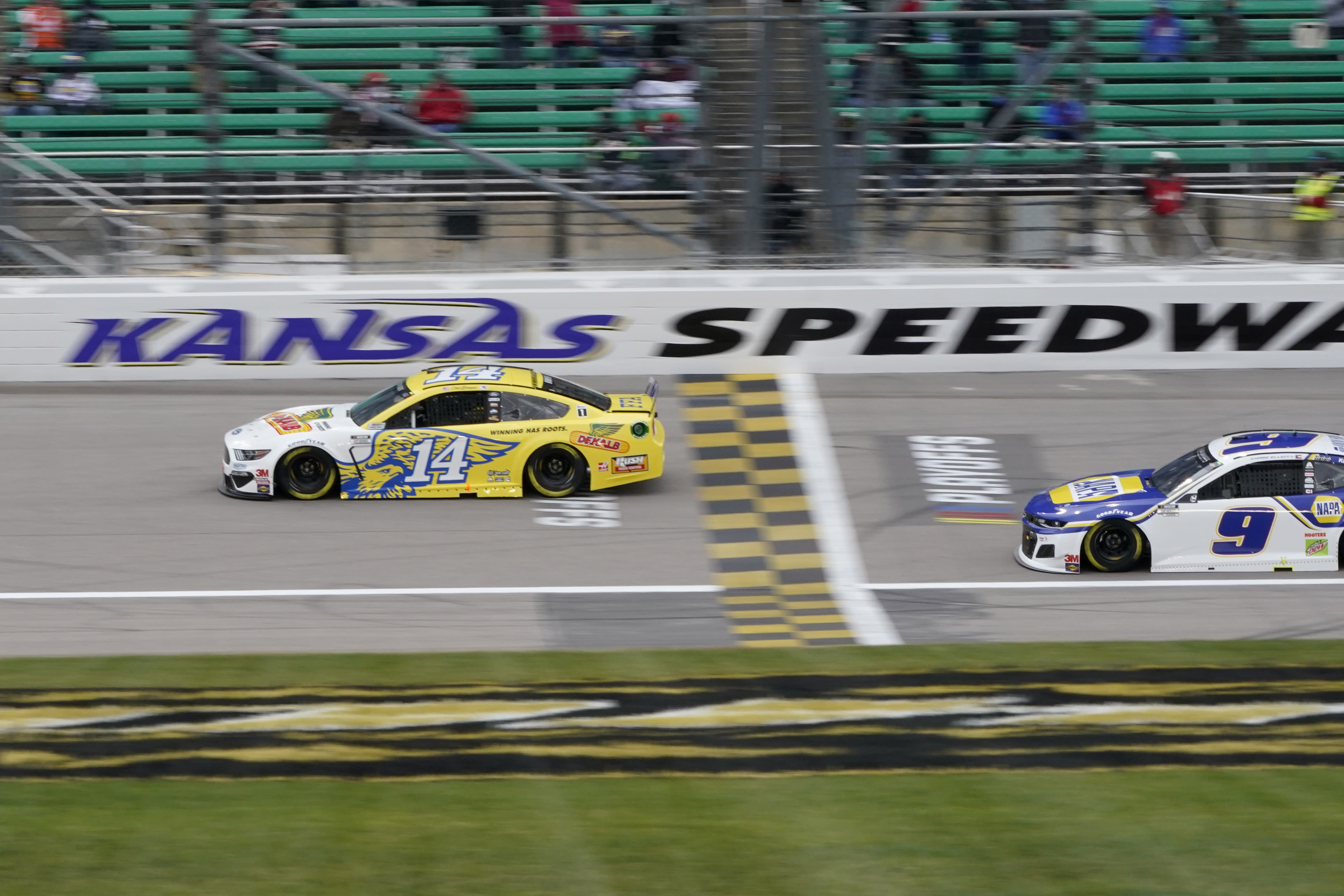 Clint Bowyer (14) leads a pace lap in honor of his final season before a NASCAR Cup Series auto race at Kansas Speedway in Kansas City, Kan., Sunday, Oct. 18, 2020. (AP Photo/Orlin Wagner)