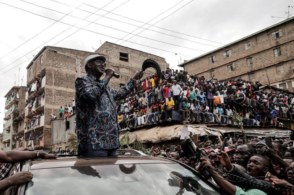 Odinga visited the Mathare district of Nairobi to speak with the family of young girl killed in election-related violence (AFP Photo/MARCO LONGARI)