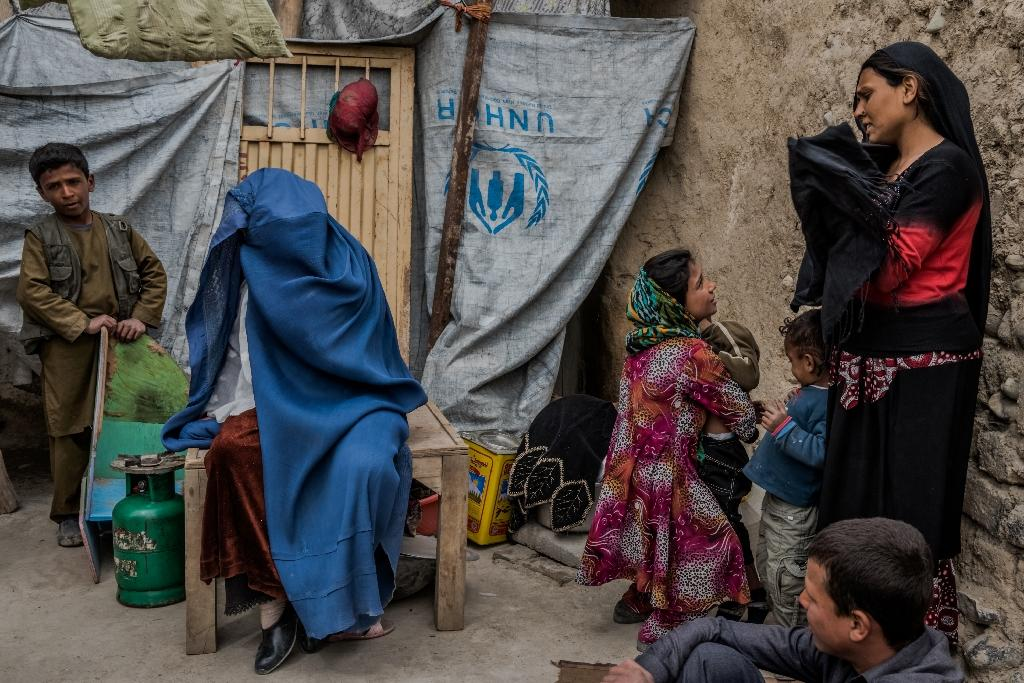 In Afghanistan, widows are often rejected as immoral or regarded as burdens: they suffer violence, expulsion, ostracism and sometimes forced remarriage, often with a brother-in-law, according to a 2014 report by the UN. (AFP Photo/Rebecca CONWAY)