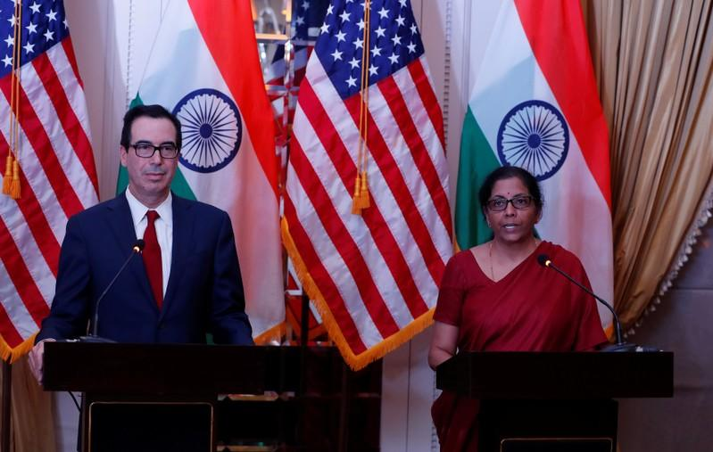 India's Finance Minister Nirmala Sitharaman speaks as U.S. Treasury Secretary Steven Mnuchin watches during a joint news conference in New Delhi